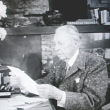 Frank L. Wright reading a letter